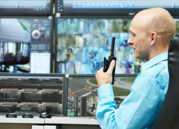 Man in Front of Security Monitors for Alarm Monitoring Services in Pasadena, CA